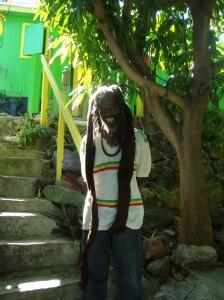 1.Rasta Bushman outside his house