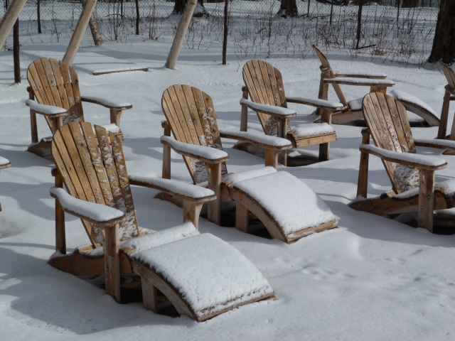Scandinave snow covered Muskoka chairs